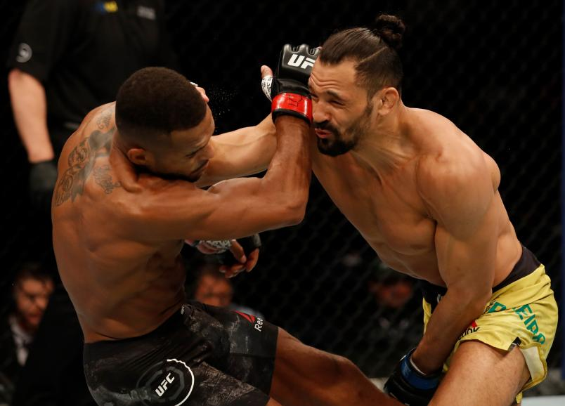 ROCHESTER, NY - MAY 18: (R-L) Michel Pereira of Brazil punches Danny Roberts of the United Kingdom in their welterweight bout during the UFC Fight Night event at Blue Cross Arena on May 18, 2019 in Rochester, New York. (Photo by Michael Owens/Zuffa LLC)