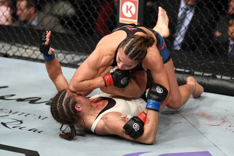 Maycee Barber land an elbow to the head of Hannah Cifers in their women's strawweight bout during the UFC Fight Night event inside Pepsi Center on November 10, 2018 in Denver, Colorado. (Photo by Josh Hedges/Zuffa LLC/Zuffa LLC via Getty Images)