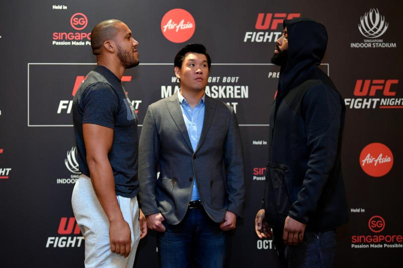 SINGAPORE, SINGAPORE - OCTOBER 24: (L-R) Opponents Ciryl Gane of France and Don'Tale Mayes face off during the UFC Fight Night Ultimate Media Day at the Mandarin Oriental on October 24, 2019 in Singapore, Singapore. (Photo by Jeff Bottari/Zuffa LLC via Getty Images)