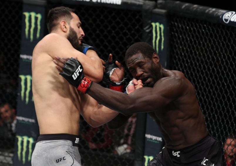 Dominick Reyes punches Jared Cannonier in their light heavyweight bout during the UFC Fight Night event at Movistar Arena on May 19, 2018 in Santiago, Chile. (Photo by Buda Mendes/Zuffa LLC/Zuffa LLC via Getty Images)