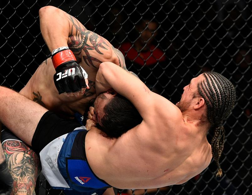FRESNO, CA - DECEMBER 09: (R-L) Brian Ortega attempts to submit Cub Swanson in their featherweight bout during the UFC Fight Night event inside Save Mart Center on December 9, 2017 in Fresno, California. (Photo by Jeff Bottari/Zuffa LLC/Zuffa LLC via Getty Images)