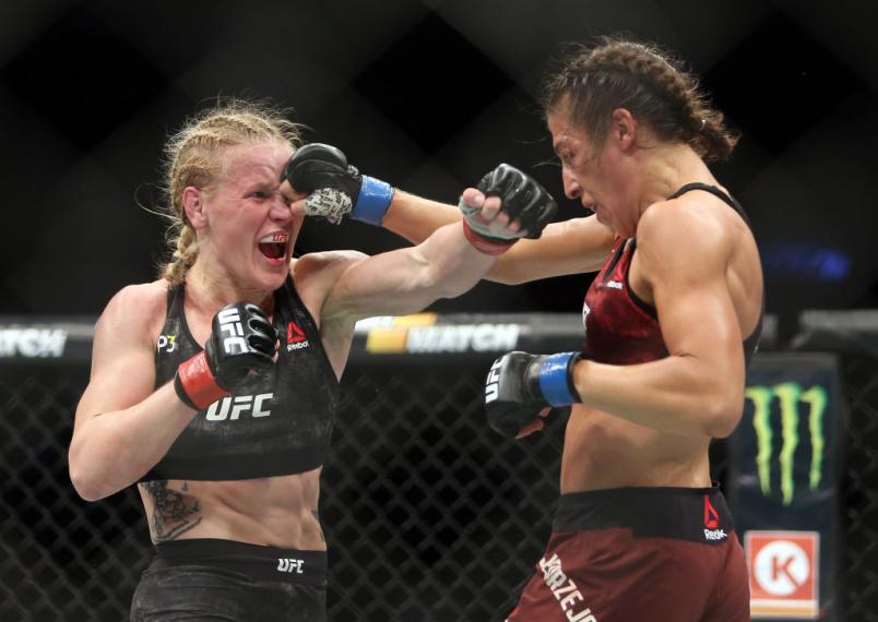 Joanna Jedrzejczyk of Poland fights against Valentina Shevchenko (L) of Kyrgyzstan in a flyweight bout during the UFC 231