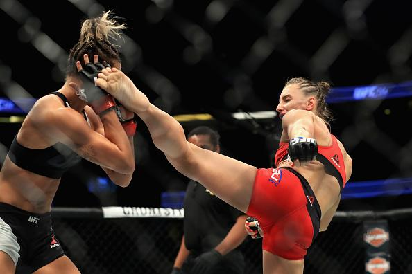 ANAHEIM, CA - JULY 29:  Kailin  Curran (Black Shorts) fights Alexandra Albu of Russia during their Woman Strawweight fight at UFC 214 at Honda Center on July 29, 2017 in Anaheim, California.  (Photo by Sean M. Haffey/Getty Images)