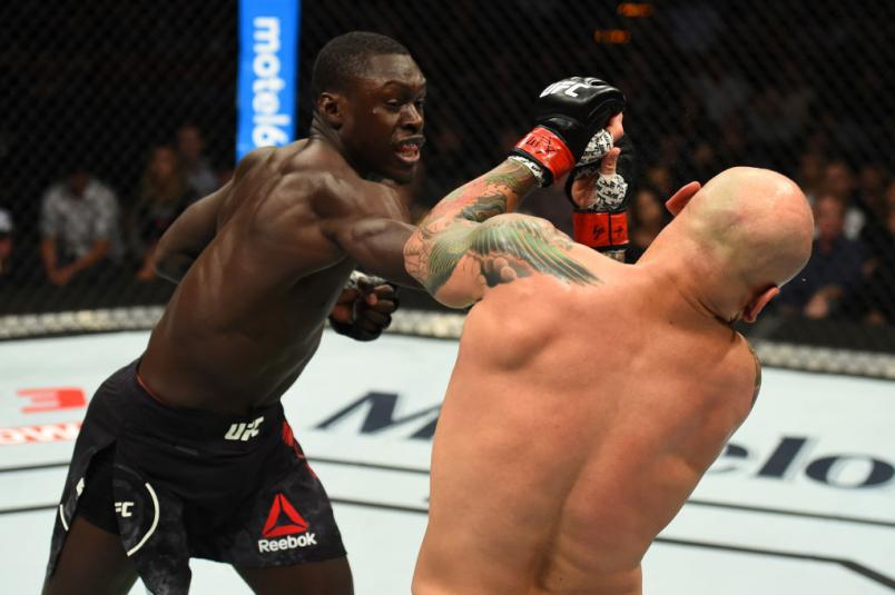 Curtis Millender (L) punches Thiago Alves of Brazil in their welterweight bout during the UFC Fight Night event at Frank Erwin Center on February 18, 2018 in Austin, Texas.  (Photo by Josh Hedges/Zuffa LLC)