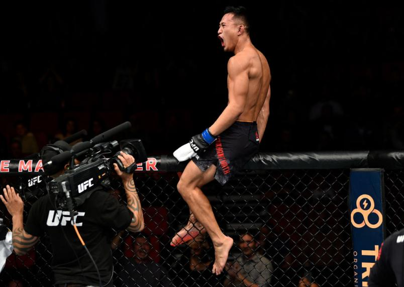 FRESNO, CA - DECEMBER 09:  Andre Soukhamthath celebrates his victory over Luke Sanders in their featherweight bout during the UFC Fight Night event inside Save Mart Center on December 9, 2017 in Fresno, California. (Photo by Jeff Bottari/Zuffa LLC/Zuffa L