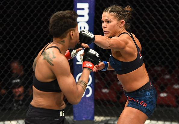 GLENDALE, AZ - APRIL 14:  (R-L) Lauren Mueller punches Shana Dobson in their women's flyweight fight during the UFC Fight Night event at the Gila Rivera Arena on April 14, 2018 in Glendale, Arizona. (Photo by Josh Hedges/Zuffa LLC/Zuffa LLC via Getty Imag