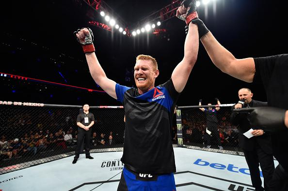 MEXICO CITY, MEXICO - AUGUST 05:  Sam Alvey celebrates his victory over Rashad Evans in their middleweight bout during the UFC Fight Night event at Arena Ciudad de Mexico on August 5, 2017 in Mexico City, Mexico. (Photo by Jeff Bottari/Zuffa LLC/Zuffa LLC