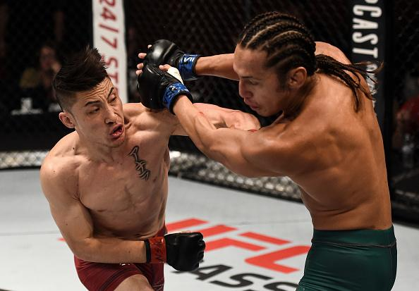 LAS VEGAS, NV - JULY 11:  (L-R) Boston Salmon punches Ricky Turcios in their bantamweight bout during Dana White's Tuesday Night Contender Series at the TUF Gym on July 11, 2017 in Las Vegas, Nevada. (Photo by Brandon Magnus/DWTNCS)