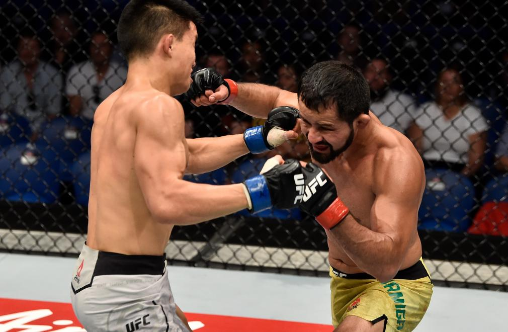 PERTH, AUSTRALIA - FEBRUARY 11: (R-L) Jussier Formiga of Brazil exchanges punches with Ben Nguyen in their flyweight bout during the UFC 221 event at Perth Arena on February 11, 2018 in Perth, Australia. (Photo by Jeff Bottari/Zuffa LLC/Zuffa LLC via Getty Images)