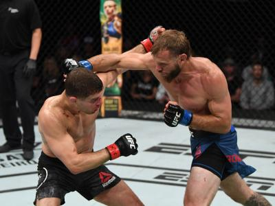 OTTAWA, ON - MAY 04: (R-L) Donald Cerrone punches Al Iaquinta in their lightweight bout during the UFC Fight Night event at Canadian Tire Centre on May 4, 2019 in Ottawa, Ontario, Canada. (Photo by Jeff Bottari/Zuffa LLC/Zuffa LLC via Getty Images)