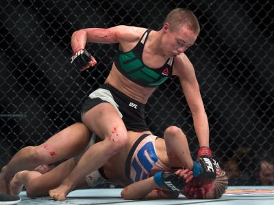 Rose Namajunas punches Paige VanZant in their women's strawweight bout during the UFC Fight Night event at The Chelsea at the Cosmopolitan of Las Vegas on December 10, 2015 in Las Vegas, Nevada. (Photo by Brandon Magnus/Zuffa LLC)