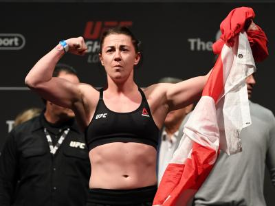 LONDON, ENGLAND - MARCH 15: Molly McCann of United Kingdom poses on the scale during the UFC Fight Night weigh-in at The O2 on March 15, 2019 in London, England. (Photo by Jeff Bottari/Zuffa LLC/Zuffa LLC via Getty Images)