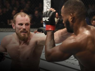 LONDON, ENGLAND - MARCH 16: (L-R) Gunnar Nelson of Iceland punches Leon Edwards of England in their welterweight bout during the UFC Fight Night event at The O2 Arena on March 16, 2019 in London, England. (Photo by Jeff Bottari/Zuffa LLC/Zuffa LLC via Getty Images)