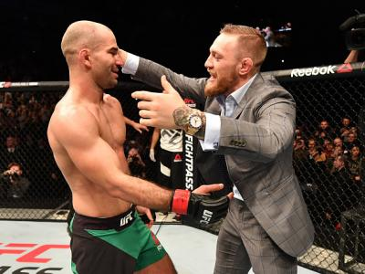 BELFAST, NORTHERN IRELAND - NOVEMBER 19:  (L-R) Artem Lobov of Russia celebrates with teammate and UFC champion Conor McGregor after his featherweight bout against Teruto Ishihara during the UFC Fight Night at the SSE Arena on November 19, 2016 in Belfast