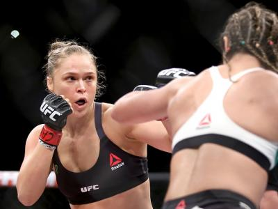 RIO DE JANEIRO, BRAZIL - AUGUST 01:  Ronda Rousey of the United States (red) fights Bethe Correia of Brazi (blue) l in their bantamweight title fight during the UFC 190 Rousey v Correia at HSBC Arena on August 1, 2015 in Rio de Janeiro, Brazil.  (Photo by