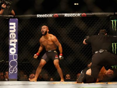 LAS VEGAS, NV - APRIL 23:  Demetrious Johnson celebrates his TKO victory over Henry Cejudo in their flyweight championship bout during the UFC 197 event inside MGM Grand Garden Arena on April 23, 2016 in Las Vegas, Nevada.  (Photo by Christian Petersen/Zu