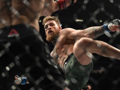 Conor McGregor of Ireland kicks Khabib Nurmagomedov of Russia in their UFC lightweight championship bout during the UFC 229