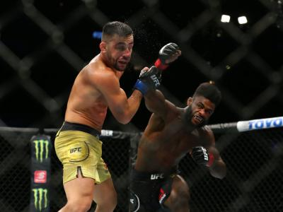 Aljamain Sterling (R) punches Pedro Munhoz (L) at United Center on June 8, 2019 in Chicago