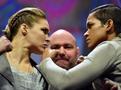 NEW YORK, NY - NOVEMBER 11:  UFC 207 opponents Ronda Rousey (L) and Amanda Nunes (R) face off after the UFC 205 weigh-in inside Madison Square Garden on November 11, 2016 in New York City. (Photo by Brandon Magnus/Zuffa LLC/Zuffa LLC via Getty Images)