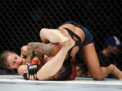 EDMONTON, AB - SEPTEMBER 09:  Sarah Moras, left, fights Ashley Evans-Smith during UFC 215 at Rogers Place on September 9, 2017 in Edmonton, Canada. (Photo by Codie McLachlan/Getty Images)