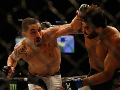 LAS VEGAS, NV - APRIL 23:  (L-R) Robert Whittaker of New Zealand punches Rafael Natal in their middleweight bout during the UFC 197 event inside MGM Grand Garden Arena on April 23, 2016 in Las Vegas, Nevada.  (Photo by Christian Petersen/Zuffa LLC/Zuffa L