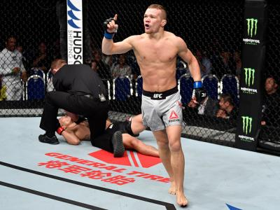 SINGAPORE - JUNE 23:  Petr Yan of Russia celebrates after his knockout victory over Teruto Ishihara of Japan in their bantamweight bout during the UFC Fight Night event at the Singapore Indoor Stadium on June 23, 2018 in Singapore. (Photo by Jeff Bottari/