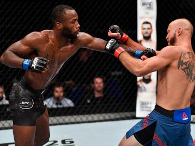 SINGAPORE - JUNE 23:  (L-R) Leon Edwards of Jamaica punches Donald Cerrone in their welterweight bout during the UFC Fight Night event at the Singapore Indoor Stadium on June 23, 2018 in Singapore. (Photo by Jeff Bottari/Zuffa LLC/Zuffa LLC via Getty Imag