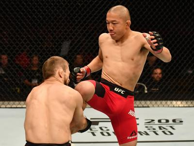 BELFAST, NORTHERN IRELAND - NOVEMBER 19:  (R-L) Kyoji Horiguchi of Japan lands a flying knee against Ali Bagautinov of Russia in their flyweight bout during the UFC Fight Night at the SSE Arena on November 19, 2016 in Belfast, Northern Ireland. (Photo by