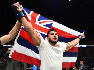 GLENDALE, AZ - APRIL 14:  Brad Tavares celebrates his victory over Krzysztof Jotko of Poland in their middleweight fight during the UFC Fight Night event at the Gila Rivera Arena on April 14, 2018 in Glendale, Arizona. (Photo by Josh Hedges/Zuffa LLC/Zuff
