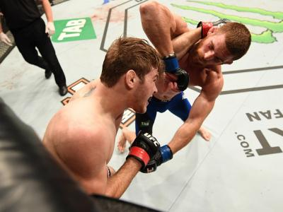 MELBOURNE, AUSTRALIA - NOVEMBER 27:   (R-L) Andrew Holbrook elbows Jake Matthews of Australia in their lightweight bout during the UFC Fight Night event at Rod Laver Arena on November 27, 2016 in Melbourne, Australia. (Photo by Jeff Bottari/Zuffa LLC/Zuff