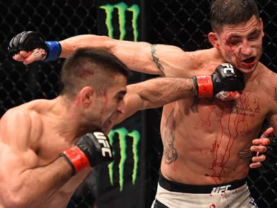 MONTERREY, MEXICO - NOVEMBER 21:  (L-R) Ricardo Lamas of the United States punches Diego Sanchez of the United States in their featherweight bout during the UFC Fight Night event at Arena Monterrey on November 21, 2015 in Monterrey, Mexico.  (Photo by Jef
