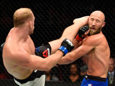 PORTLAND, OR - OCTOBER 01:  (L-R) Zak Ottow lands a head kick against Joshua Burkman in their welterweight bout during the UFC Fight Night event at the Moda Center on October 1, 2016 in Portland, Oregon. (Photo by Josh Hedges/Zuffa LLC/Zuffa LLC via Getty