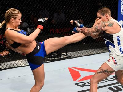 VANCOUVER, BC - AUGUST 27:  (L-R) Paige VanZant of the United States kicks Bec Rawlings of Australia in their women's strawweight bout during the UFC Fight Night event at Rogers Arena on August 27, 2016 in Vancouver, British Columbia, Canada. (Photo by Je