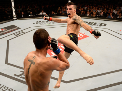 SAO PAULO, BRAZIL - NOVEMBER 07:  Thomas Almeida of Brazil kicks Anthony Birchak of the United States in their bantamweight bout during the UFC Fight Night Belfort v Henderson at Ibirapuera Gymnasium on November 7, 2015 in Sao Paulo, Brazil.  (Photo by Bu