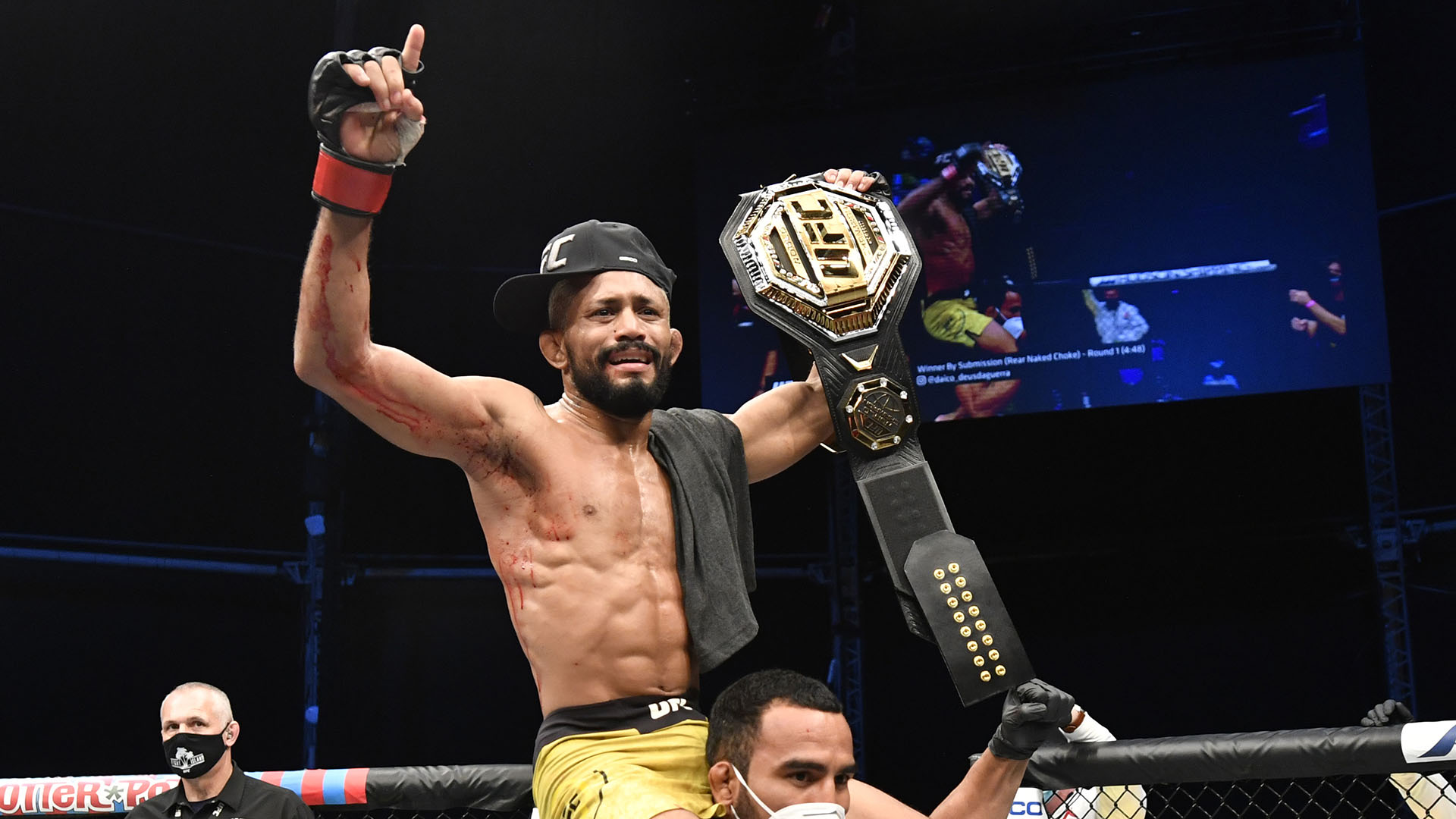 Deiveson Figueiredo celebrates after defeating Joseph Benavidez in their UFC flyweight championship bout on July 19, 2020 on UFC FIGHT ISLAND (Photo by Jeff Bottari/Zuffa LLC)