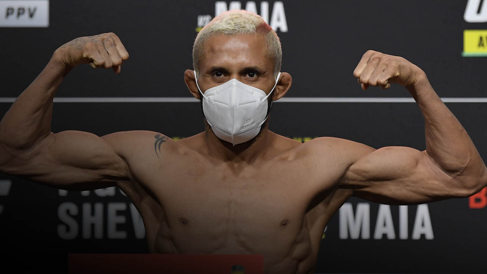 Deiveson Figueiredo of Brazil poses on the scale during the UFC 255 weigh-in at UFC APEX on November 20, 2020 in Las Vegas, Nevada. (Photo by Jeff Bottari/Zuffa LLC)