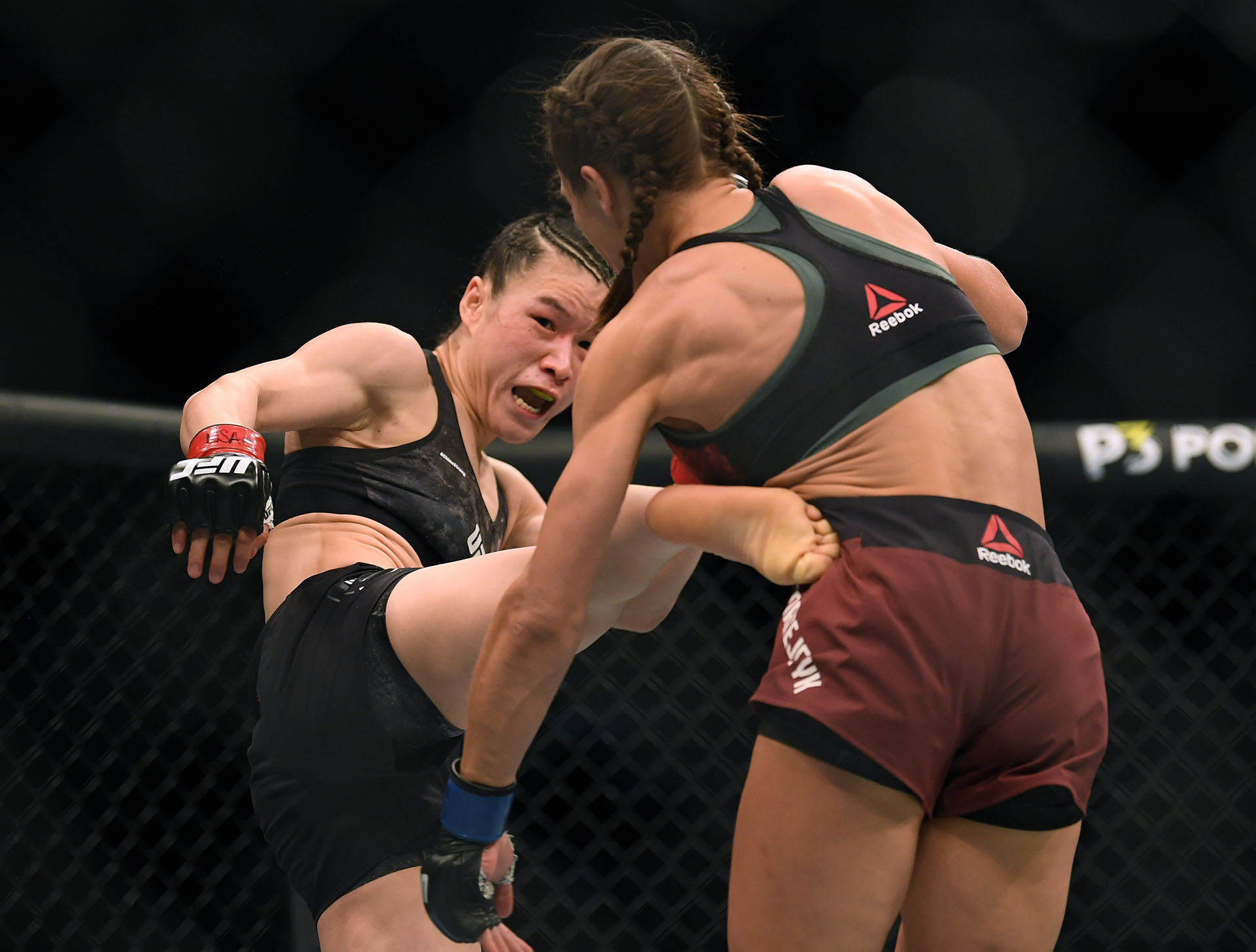 Weili Zhang kicks Joanna Jedrzejczyk during her split decision win to retain her strawweight title at T-Mobile Arena on March 07, 2020 in Las Vegas, Nevada. (Photo by Harry How/Getty Images)