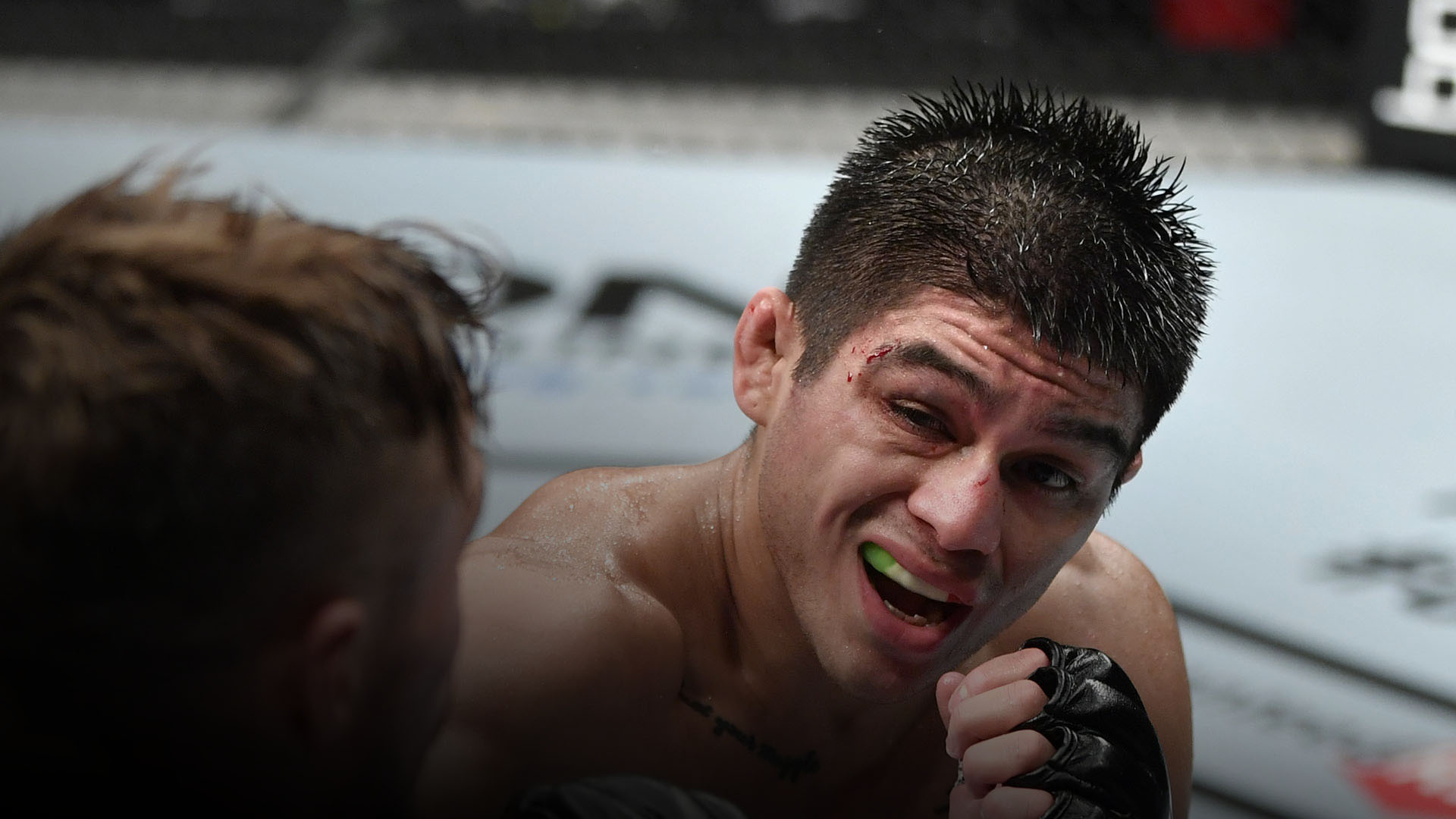 John Castaneda punches Nathaniel Wood of England in their bantamweight fight during the UFC Fight Night event inside Flash Forum on UFC Fight Island on July 26, 2020 in Yas Island, Abu Dhabi, United Arab Emirates. (Photo by Jeff Bottari/Zuffa LLC)