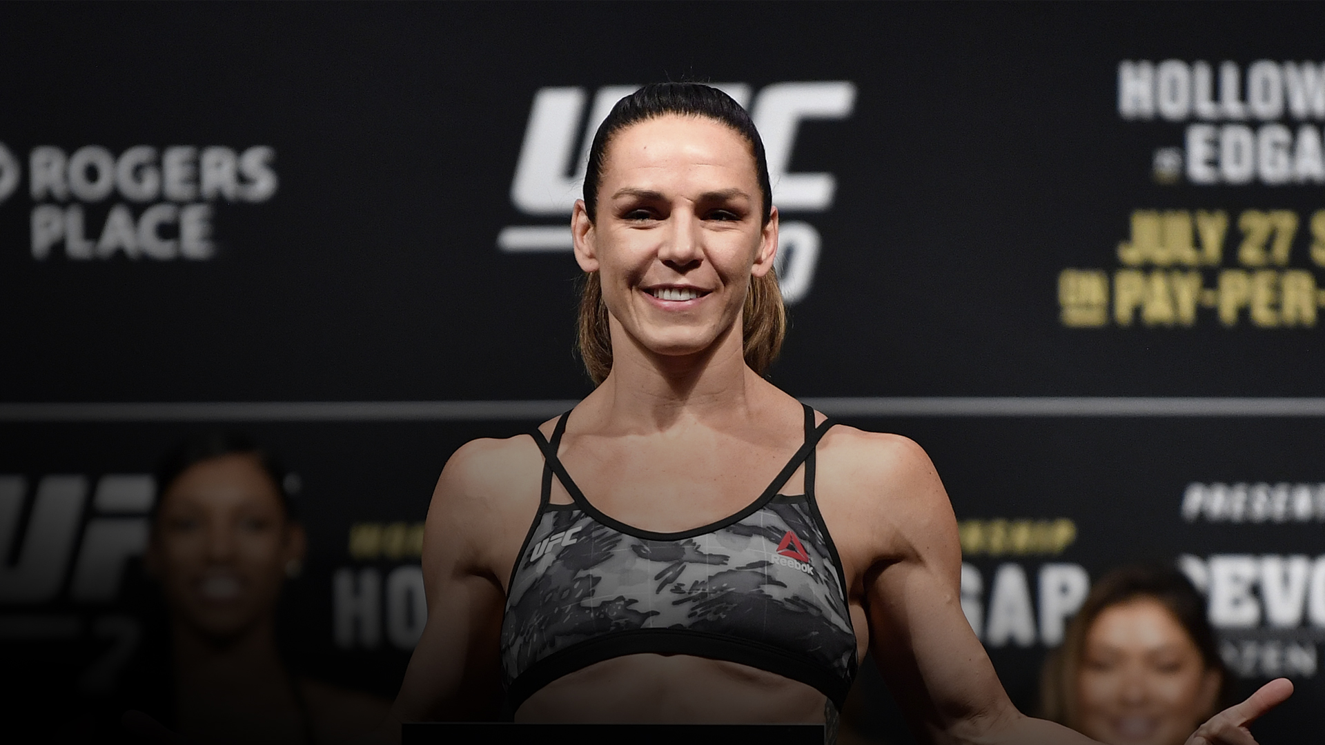 Alexis Davis of Canada poses on the scale during the UFC 240 weigh-in at Rogers Place on July 26, 2019 in Edmonton, Alberta, Canada. (Photo by Jeff Bottari/Zuffa LLC