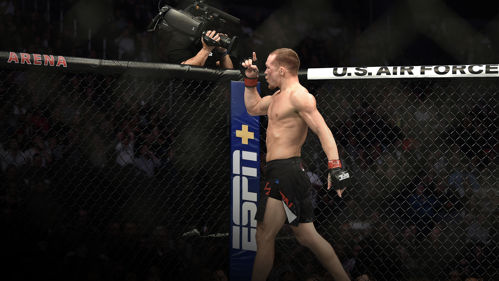 Petr Yan of Russia celebrates his victory in the octagon during the UFC 245 event at T-Mobile Arena on December 14, 2019 in Las Vegas, Nevada. (Photo by Chris Unger/Zuffa LLC)