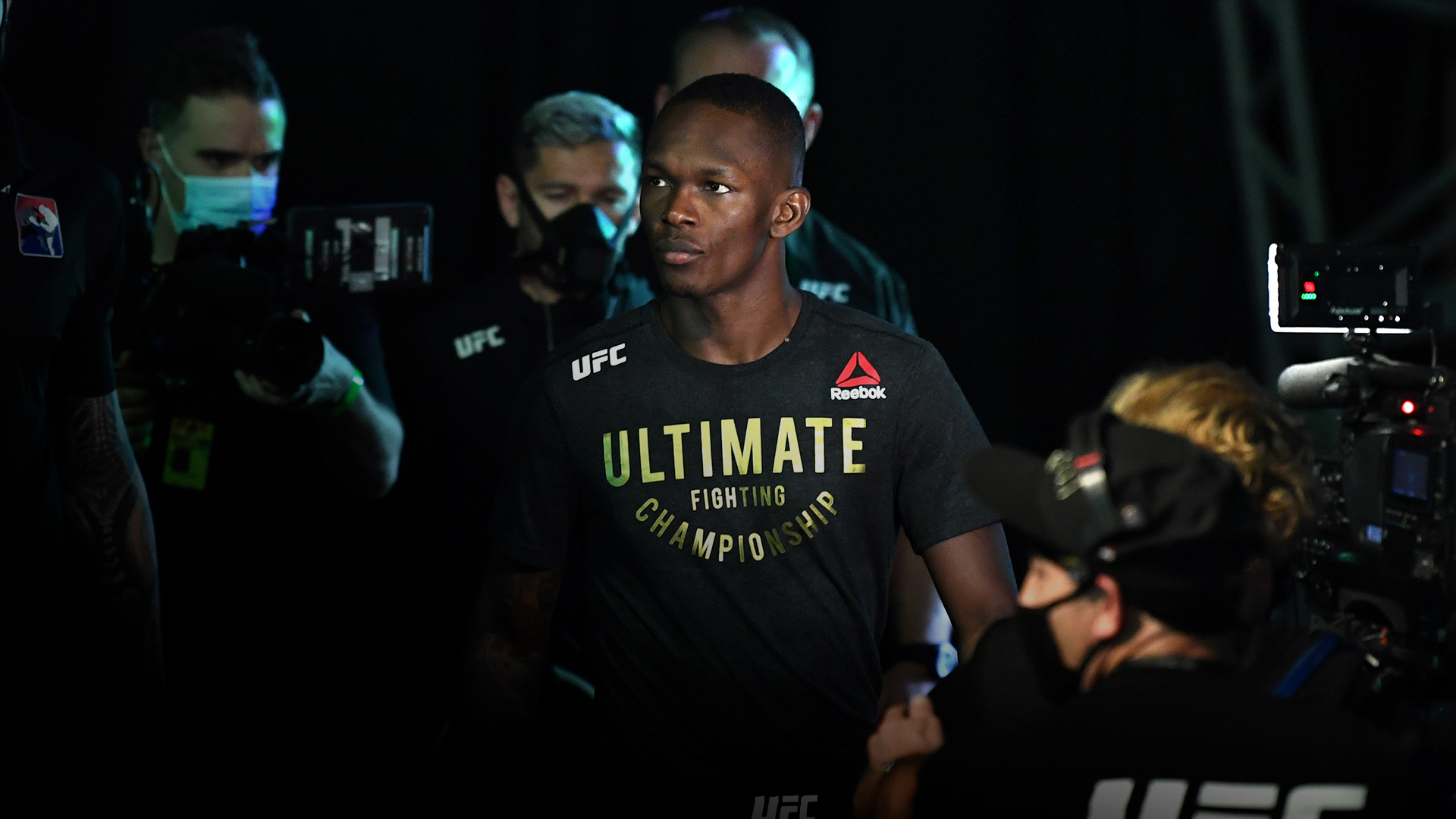 Israel Adesanya of Nigeria walks out towards the Octagon prior to facing Paulo Costa of Brazil in their middleweight championship bout during UFC 253 inside Flash Forum on UFC Fight Island on September 27, 2020 in Abu Dhabi, United Arab Emirates. (Photo by Josh Hedges/Zuffa LLC)