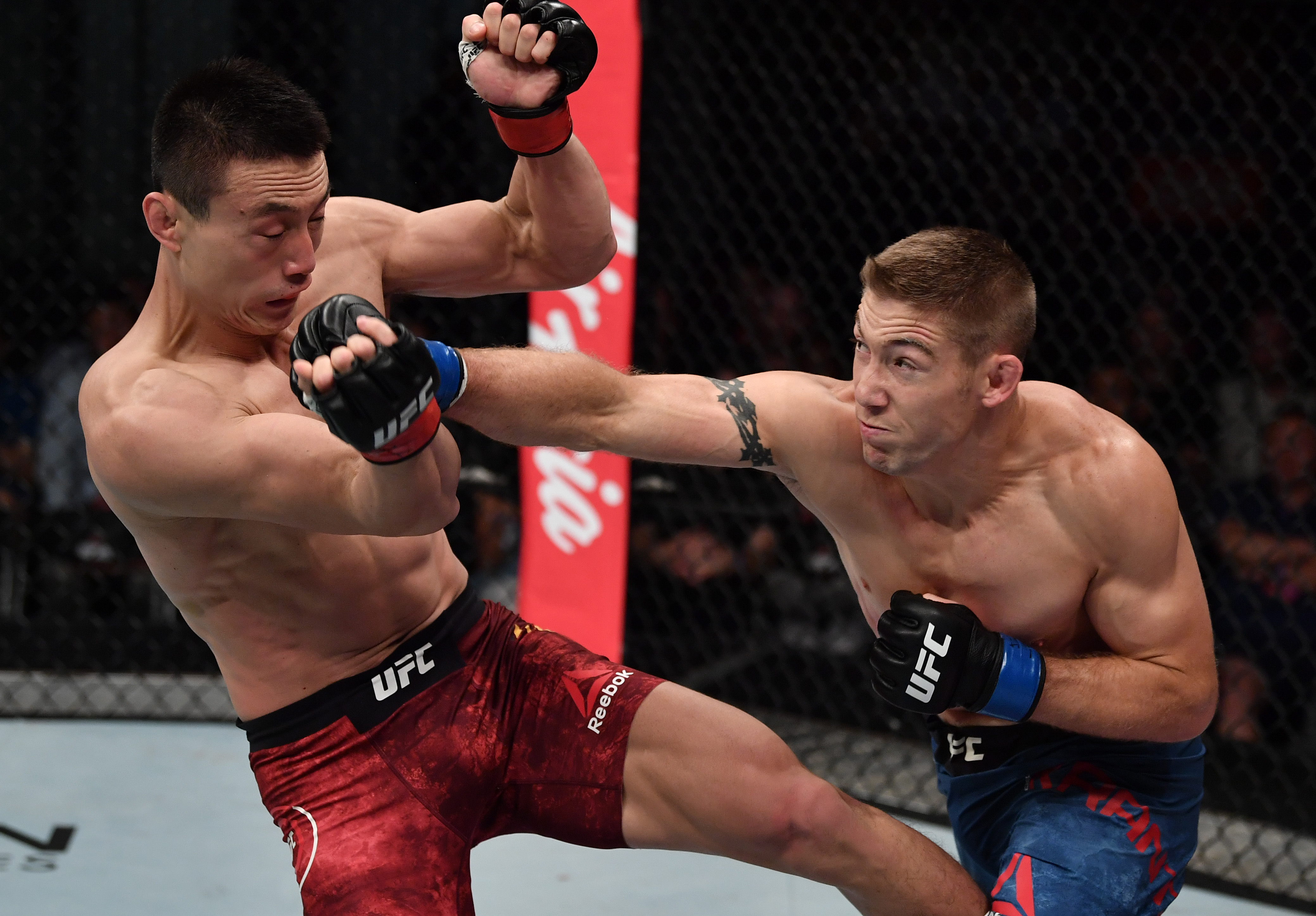 Derrick Krantz punches Song Kenan of China in their welterweight bout during the UFC Fight Night event at Shenzhen Universiade Sports Centre on August 31, 2019 in Shenzhen, China. (Photo by Brandon Magnus/Zuffa LLC)