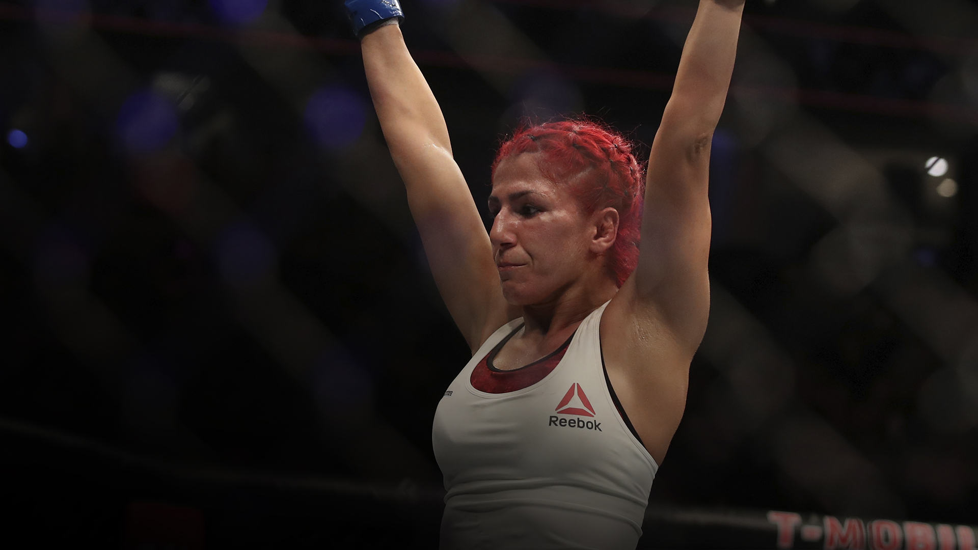 Randa Markos of Canada raises he hand at the finish of the match against Claudia Gadelha of Brazil in their strawweight fight during the UFC 239 event at T-Mobile Arena on July 6, 2019 in Las Vegas, Nevada. (Photo by Christian Petersen/Zuffa LLC)