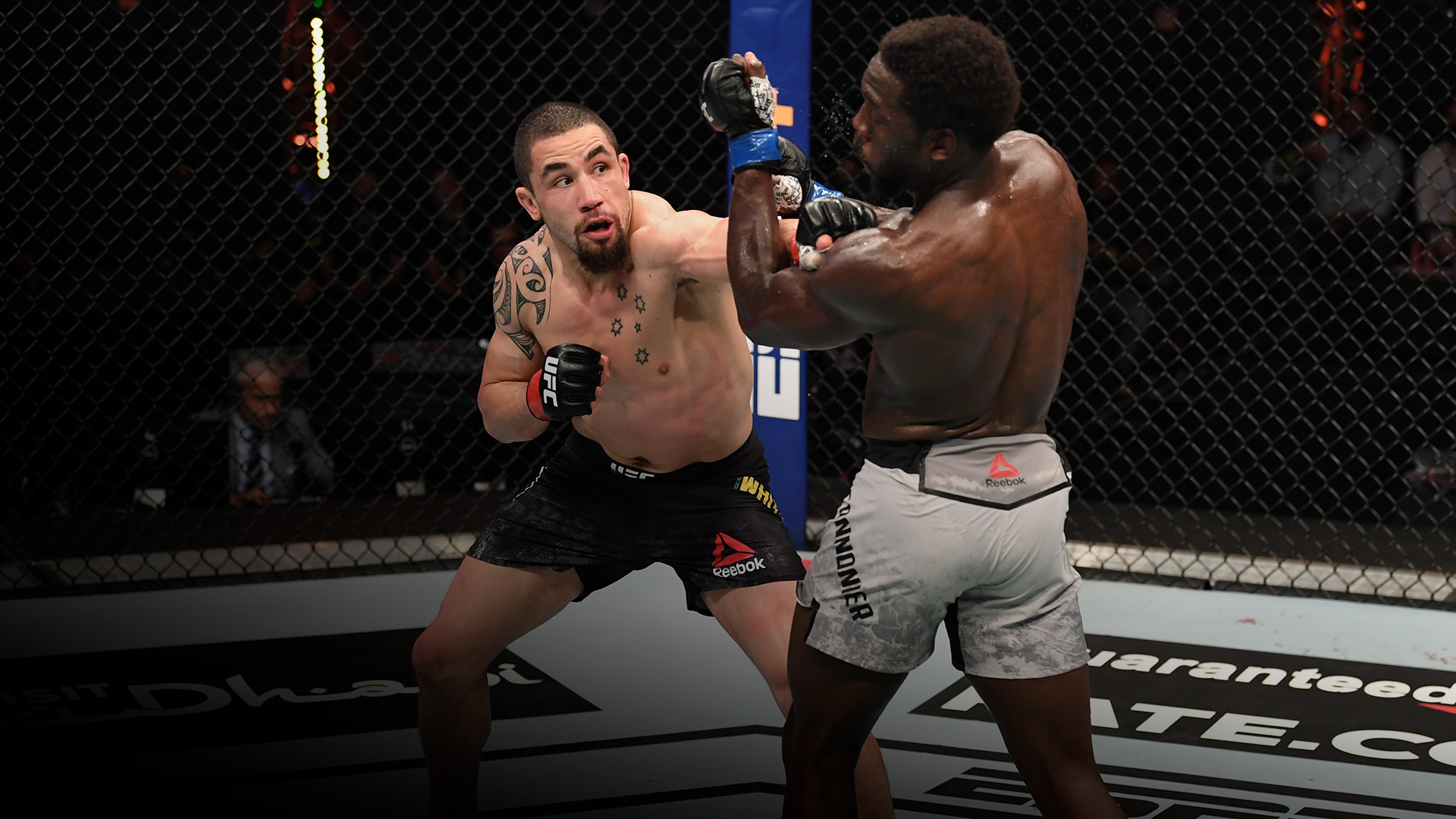Robert Whittaker of Australia punches Jared Cannonier in their middleweight bout during the UFC 254 event on October 25, 2020 on UFC Fight Island, Abu Dhabi, United Arab Emirates. (Photo by Josh Hedges/Zuffa LLC via Getty Images)