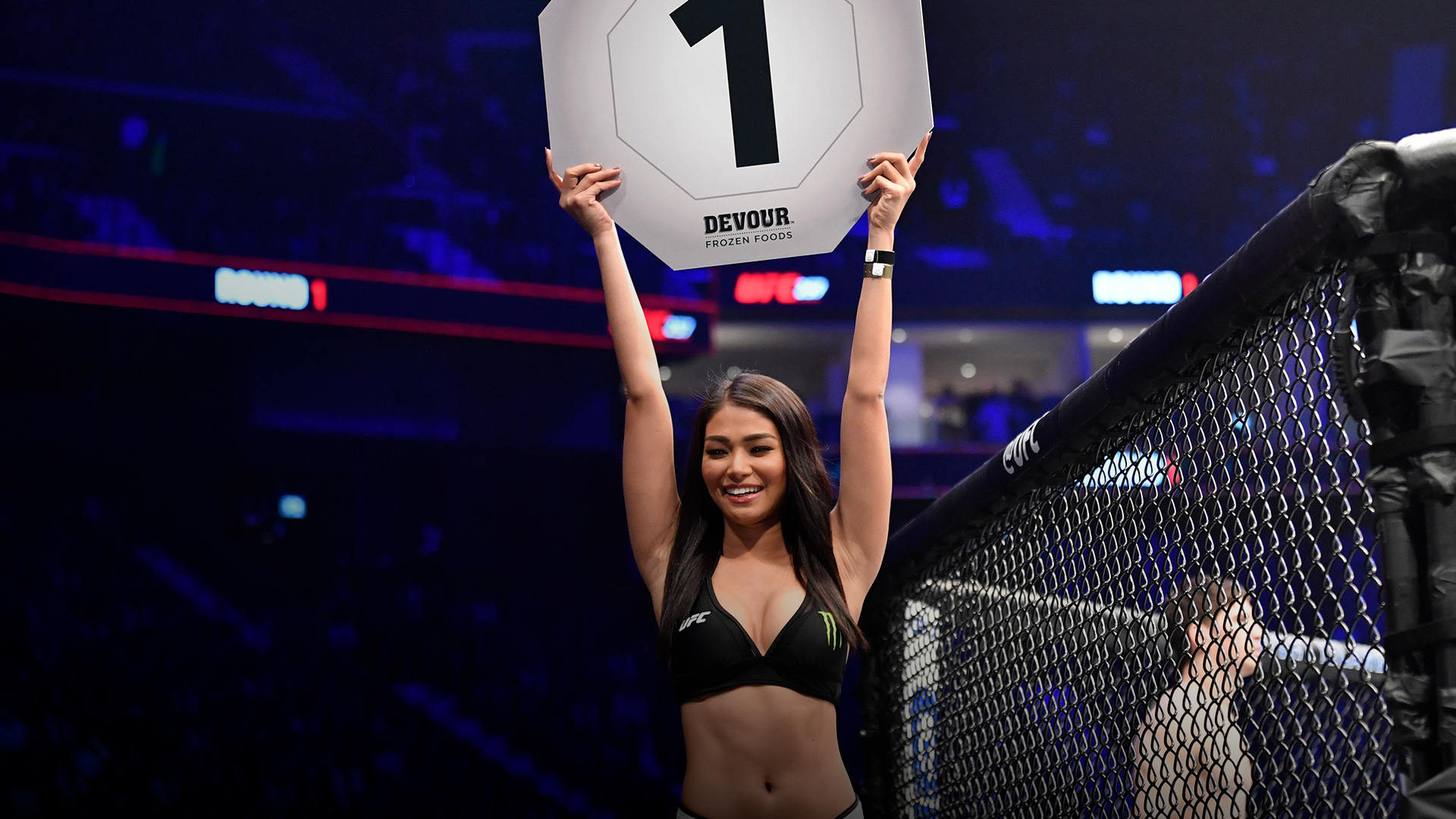 UFC Octagon Girl Red Dela Cruz introduces a round during the UFC 257 event inside Etihad Arena on UFC Fight Island on January 23, 2021 in Abu Dhabi, United Arab Emirates. (Photo by Jeff Bottari/Zuffa LLC)