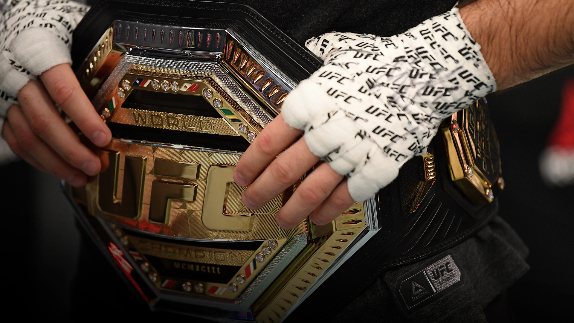 A detail shot of Khabib Nurmagomedov's belt after he announces his retirement in the Octagon after his victory over Justin Gaethje in their lightweight title bout during the UFC 254 event on October 25, 2020 on UFC Fight Island, Abu Dhabi, United Arab Emirates. (Photo by Josh Hedges/Zuffa LLC)