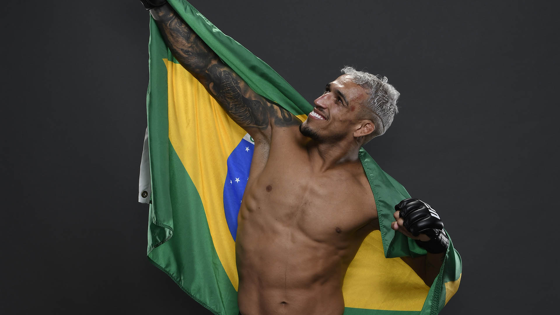 Charles Oliveira of Brazil poses for a portrait backstage after his victory during the UFC Fight Night event on March 14, 2020 in Brasilia, Brazil. (Photo by Mike Roach/Zuffa LLC)