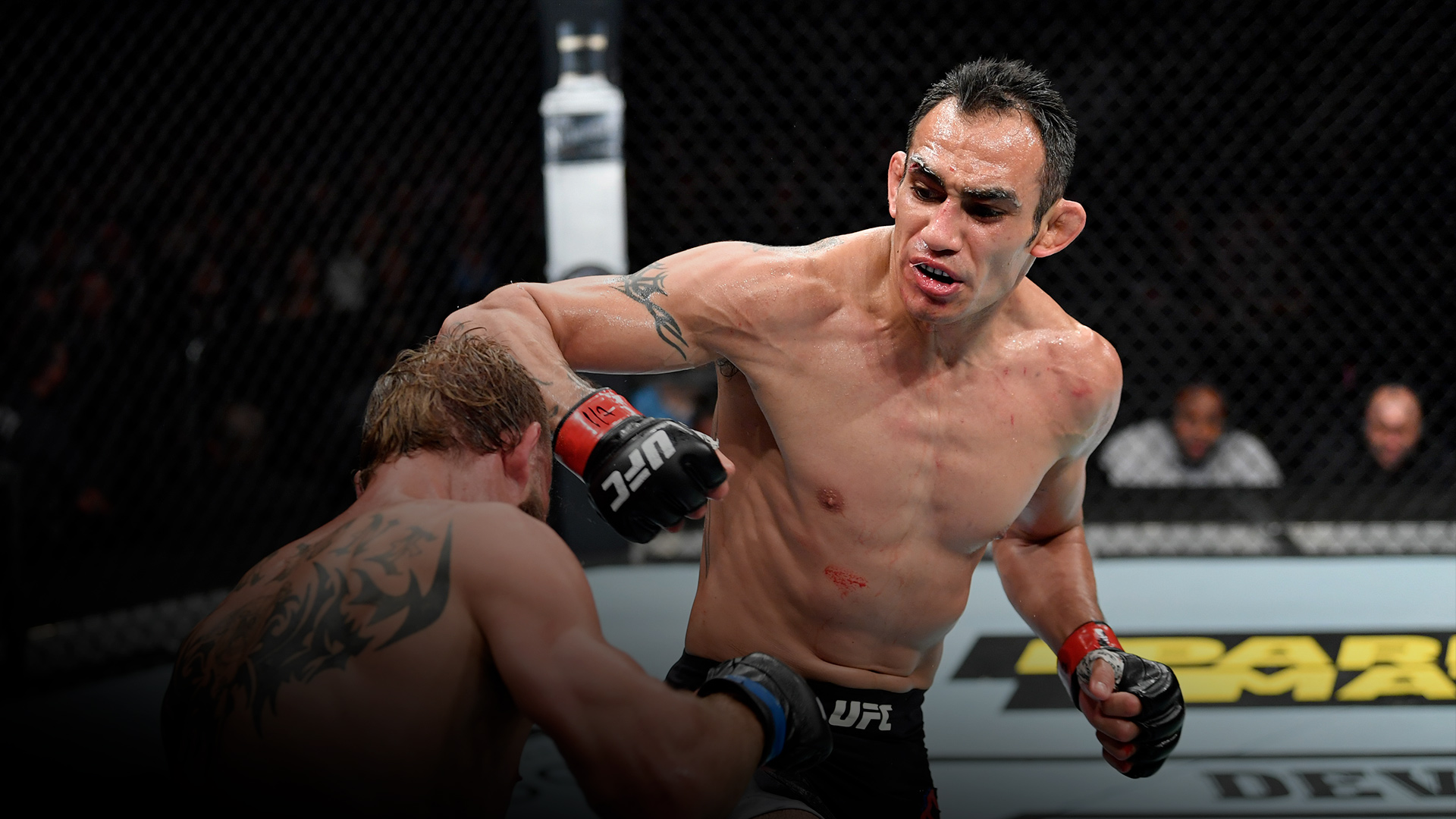 Tony Ferguson punches Donald Cerrone in their lightweight bout during the UFC 238 event at the United Center on June 8, 2019 in Chicago, Illinois. (Photo by Jeff Bottari/Zuffa LLC)