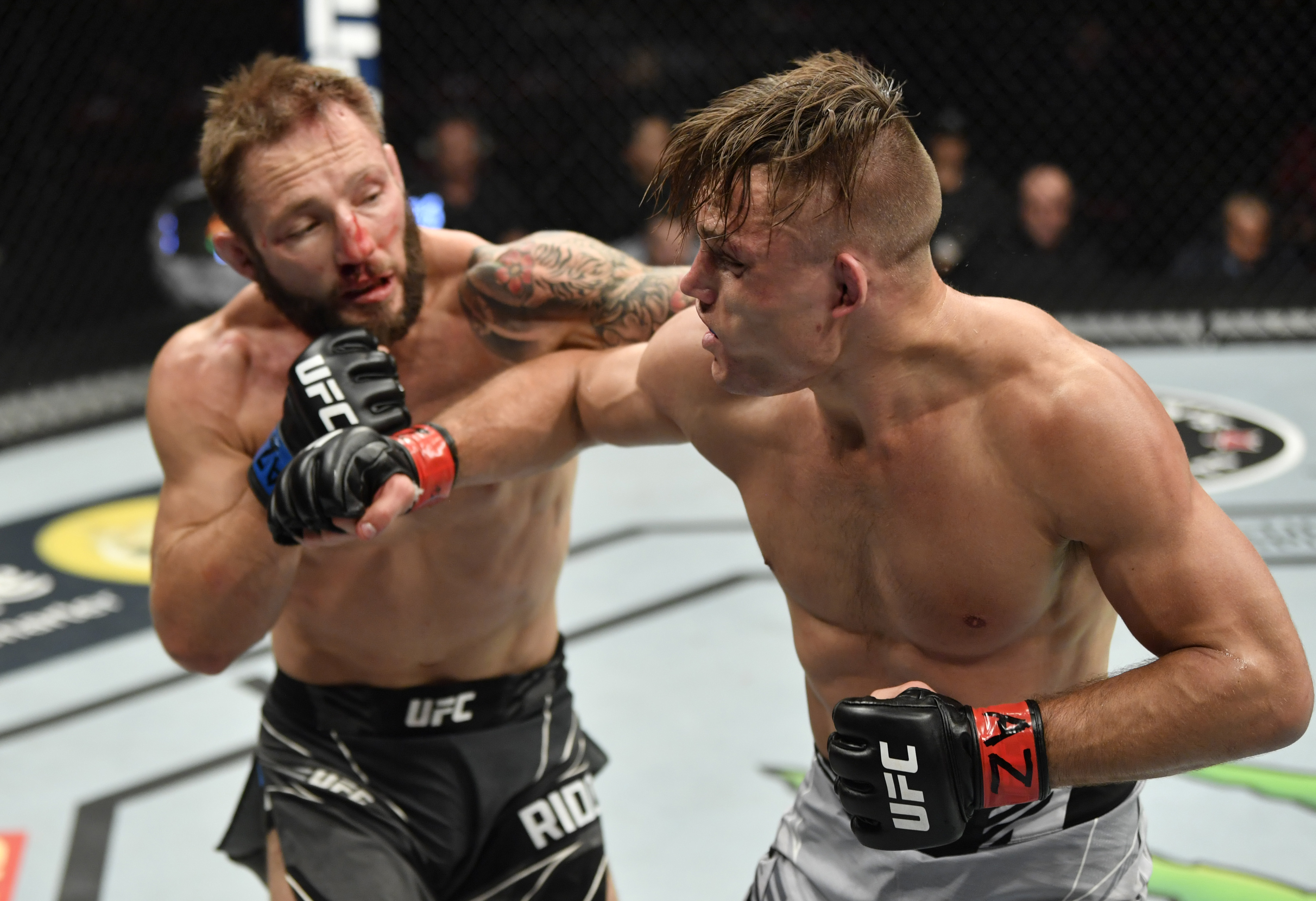 Brad Riddell of New Zealand punches Drew Dober in their lightweight fight during the UFC 263 event at Gila River Arena on June 12, 2021 in Glendale, Arizona. (Photo by Jeff Bottari/Zuffa LLC)