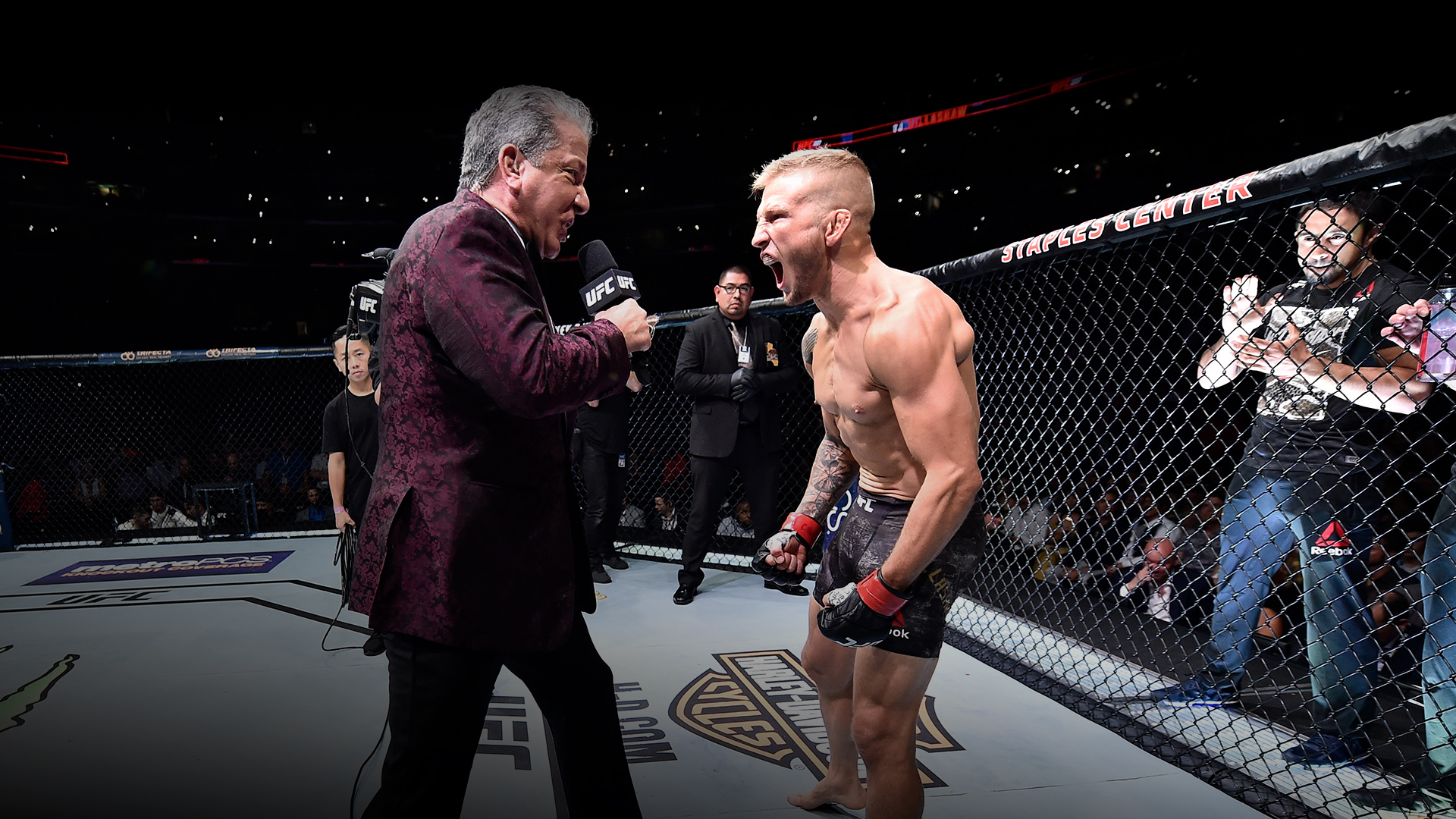 TJ Dillashaw is introduced by Bruce Buffer prior to his UFC bantamweight championship fight against Cody Garbrandt during the UFC 227 event inside Staples Center on August 4, 2018 in Los Angeles, California. (Photo by Jeff Bottari/Zuffa LLC)